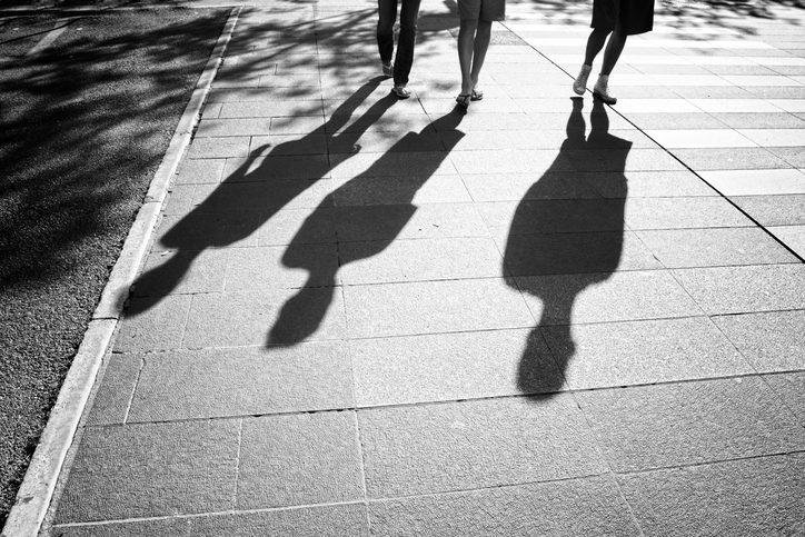 People shadows on sunny city street
