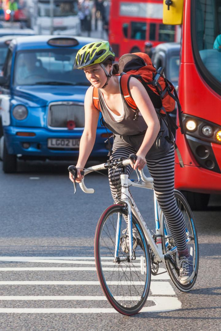 England, London, City of London, Cyclist in Traffic